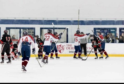 "The team celebrates one of their many wins last year. They had done very well but lost in one of the first games of the playoffs last year. ""We are a family and we all are so passionate about the sport we play. We display hard work and determination and have the true HB spirit."" said Paul Vachon '22."