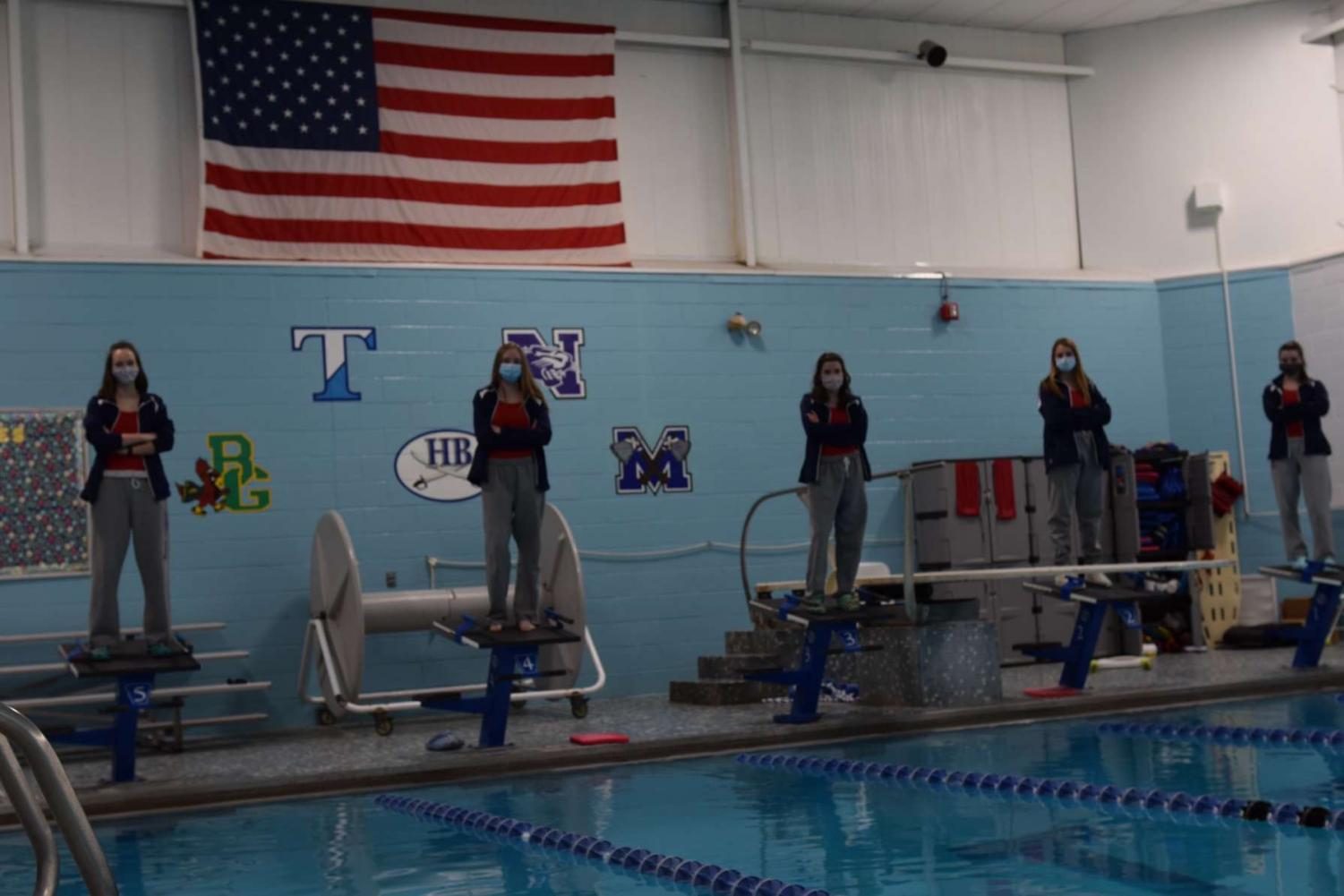 """Senior swimmers (left to right) Devin Kuchta, Delaneny Weimer, Alex Putney, Meghan Flannery, Hannah Lapointe all had senior years to remember. Filled with Covid restrictions, virtual meets, and lack of pool time, the team was still able to find success. """"Everyone on the team was just thankful to have a season and we took what we could get,"""" said Meghan Flannery '21."""