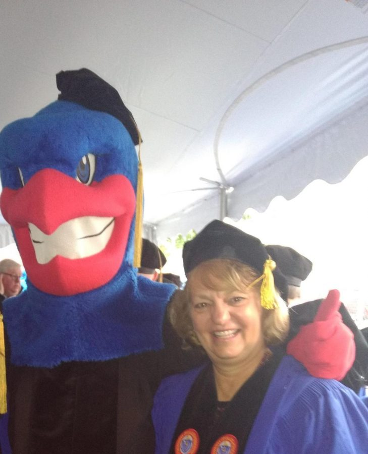 Salamone poses for a picture with the mascot at her college after her doctoral Graduation.