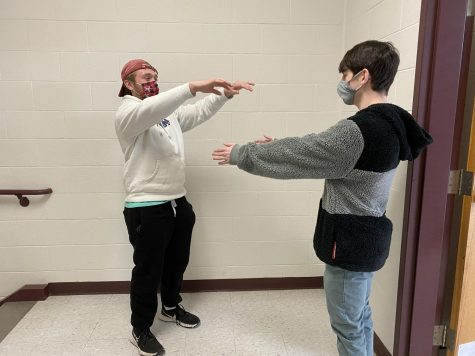 Students prepare for the possible reality of having to slow dance while maintaining social distance.
