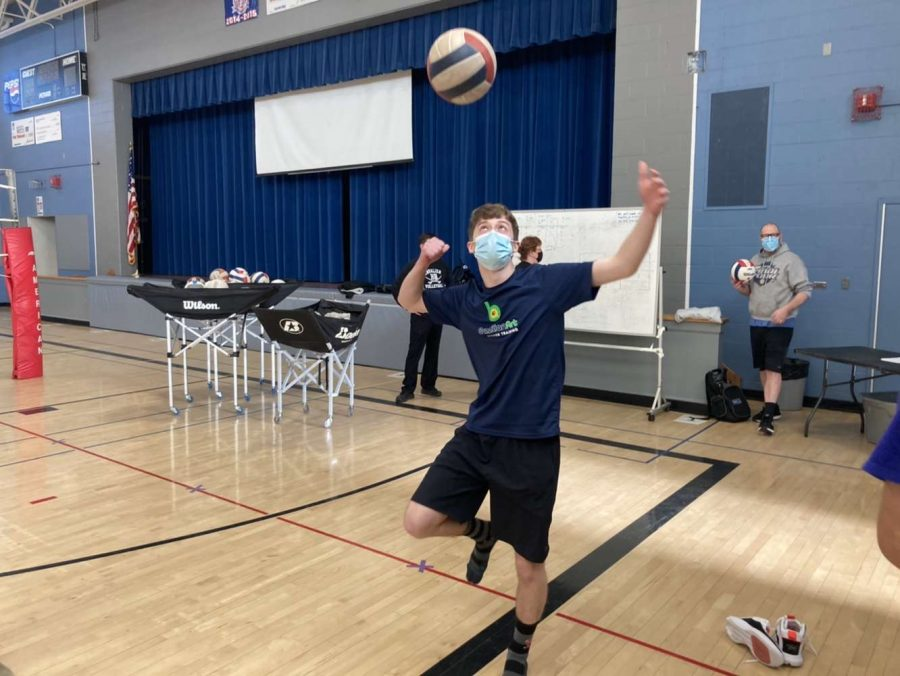 """Erik Keldsen '21 warms up for the new volleyball season during tryouts."""